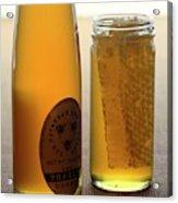 A Jar And Bottle Of Honey Acrylic Print