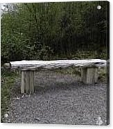 A Long Stone Section Over Wooden Stumps Forming A Rough Sitting Area Acrylic Print