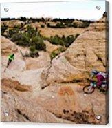 A Male And Female Mountain Biker Ride Acrylic Print