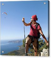 A Male Climber Looking At Paragliding Acrylic Print