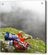 A Male Hiker Is Resting In A Grassy Acrylic Print
