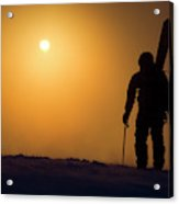 A Man Hikes Up A Mountain At Sunrise Acrylic Print