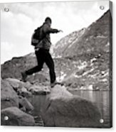 A Man Jumps From One Rock To Another Acrylic Print