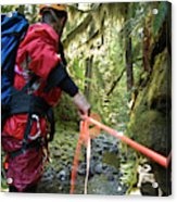 A Man Lowers A Rope For Canyoning Acrylic Print