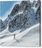 A Man Ski Touring In The Mountains Acrylic Print