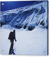 A Man Ski Touring Under Blue Skies Acrylic Print