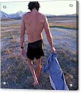 A Man Takes Off His Clothes And Walks Acrylic Print