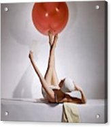 A Model Balancing A Red Ball On Her Feet Acrylic Print
