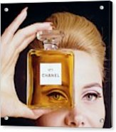 A Model Holding A Bottle Of Perfume Acrylic Print