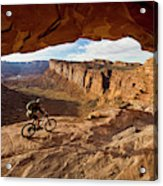 A Mountain Biker Rides By On Slickrock Acrylic Print