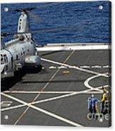 A Plane Captain Signals To A Ch-46e Sea Acrylic Print