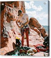 A Rock Climber Setting Up To Climb Acrylic Print