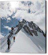 A Rope Team Climbs A Ridge Acrylic Print