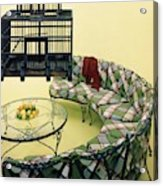 A Round Couch And A Birdcage Acrylic Print