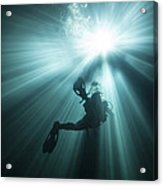 A Scuba Diver Ascends Into The Light Acrylic Print by Michael Wood