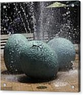 A Water Fountain With Dinosaur Eggs In The Universal Studios Singapore Acrylic Print