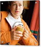 A Woman Enjoys A Warm Cup Of Cocoa Acrylic Print