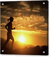 A Woman Jogs Under Sunset Acrylic Print