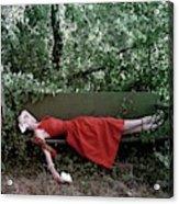 A Woman Lying On A Bench Acrylic Print