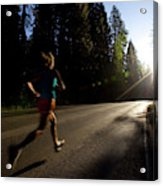 A Woman Running On A Country Road Acrylic Print