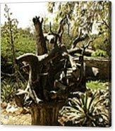 A Wooden Sculpture Inside A Garden Acrylic Print
