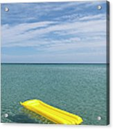A Yellow Inflatable Raft Floating On Acrylic Print