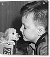 A Young Boy Is Face To Face With A Puppy Tongue. Acrylic Print