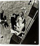 A Young Couple Lying On A Beach Acrylic Print