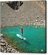 A Young Male Paddleboarding On A Small Acrylic Print