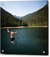 A Young Man Jumps From A Ledge Acrylic Print