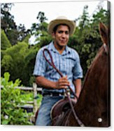 A Young Man Sits On A Horse And Smiles Acrylic Print