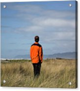 A Young Man Stands In A Field Acrylic Print