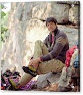 A Young Rock Climber Puts On A Climbing Acrylic Print