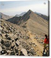 A Young Woman Hikes Borah Peak Acrylic Print