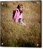 A Young Woman Sitting In A Field Acrylic Print