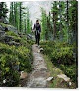 A Young Woman Walks Along An Sub-alpine Acrylic Print