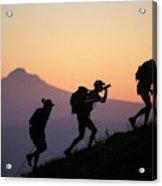 Adventure Racing Team Hiking At Sunset Acrylic Print