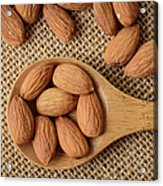 Almonds On A Spoon With Brown Background Acrylic Print