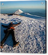 An Exhausted Climber Lies On The Summit Acrylic Print