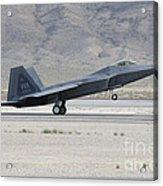 An F-22 Raptor Landing On The Runway Acrylic Print