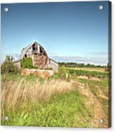 Barn In A Field With Hay Bales Acrylic Print