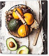 Basket With Avocado, Oranges And Dates Acrylic Print