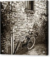Bike In Pirates Alley Acrylic Print by John Rizzuto