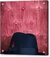 Black Hat On Red Velvet Chair Acrylic Print by Edward Fielding