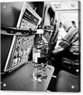 Bottle Of Water On Tray Table Interior Of Jet2 Aircraft Passenger Cabin In Flight Europe Acrylic Print by Joe Fox