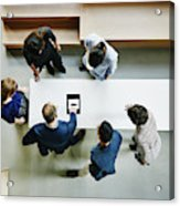 Business colleagues discussing project in office Acrylic Print