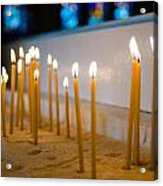 candles in the Catholic Church shallow depth of field Acrylic Print