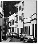 cars parked in a narrow tradtional cobble stone street in Garachico Tenerife Canary Islands Spain vertical Acrylic Print