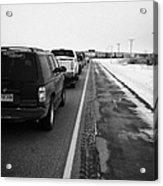 cars waiting on train crossing trans-canada highway in winter outside Yorkton Saskatchewan Canada Acrylic Print by Joe Fox