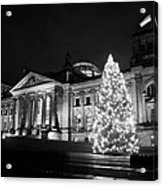 christmas tree and german flag flying fluttering on flagpole outside reichstag building Berlin Germany Acrylic Print